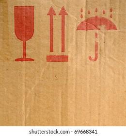 Packing symbols on old cardboard box