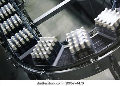 Packings of beer on a tape of conveyor