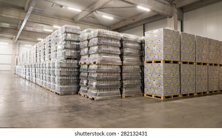 Packs Staropramen and Hoegaarden beer bottles are seen in the Molson Coors Kamenitza brewery warehouse, April 28, 2015, near the city of Haskovo, Bulgaria. Molson Coors bought Kamenitza in 2012.