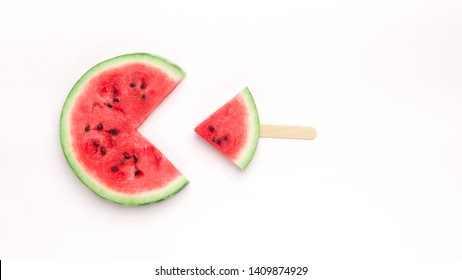 Pacman watermelon eating small fresh fruit popsicle, isolated on white background, top view