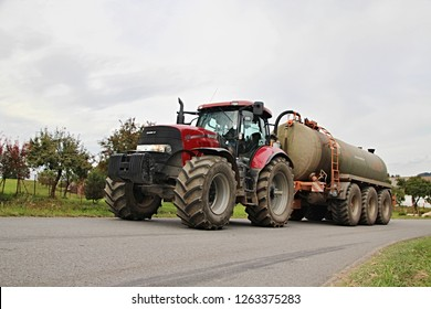 Pacov, Czech Republic, August 29 2014: Red Case tractor with slurry tank, carting digestate from biogas power plant,biofule,