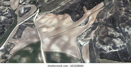 the pact,allegory, tribute to Picasso abstract photography of the Spain fields from the air, aerial view, representation of human labor camps, abstract, cubism, abstract naturalism,