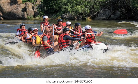 Pacuare River,  Costa Rica - March 14 2019: Rafting team , summer extreme water sport.  Group of people in a rafting boat, beautiful adrenaline ride down the river.