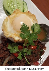 pad gra prow, holy basil stir fried red pepper, onion, topped with fried egg with beef