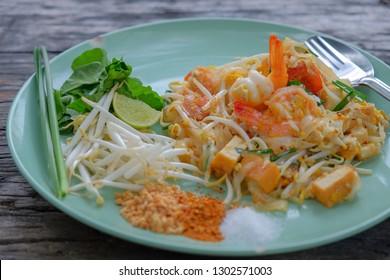 Pad thai noodle with shrimp on vintage wooden