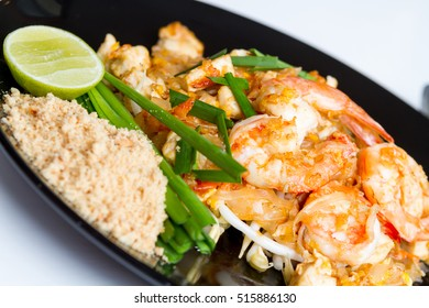 Pad thai, Close up Fried noodle thai style with shrimp on white table.