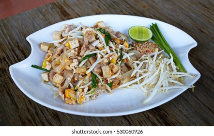 Pad Thai famous Thai food, Fried noodle with pork, vegetable, tofu, egg and sweet sauce