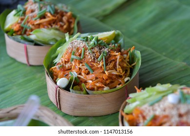 Pad Thai Goong Sod (Fried Rice Sticks with Shrimp) on bowls made of natural materials, Thai tradition food.
