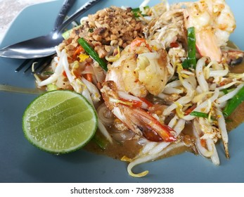 Pad Thai rice noodles menu with prawns, bean sprouts and kuicheai leaves.