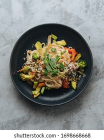 Pad thai ruce noodles with vegetables and asian sauce teriyaki - Shutterstock ID 1698668668