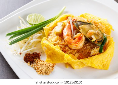 Pad Thai with shrimp mussel omelet garlic chives mung bean sprout ground chili and peanut