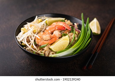 Pad Thai with shrimp on a stone background, selective focus