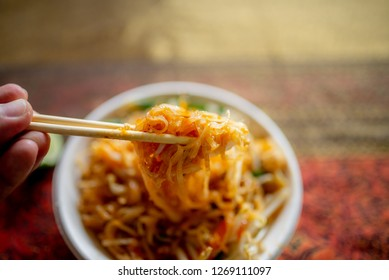 Pad Thai or tredition Thai noodles fired with shrimp or dry shrimp ,seasoning with chilly and vegetable