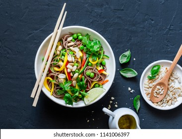 Pad Thai vegetables soba noodles on dark background, top view. Healthy vegetarian food in asian style