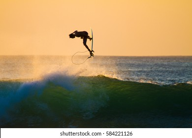 Padang Padang, Bali, Indonesia - August, 11, 2014: A surfer is seen here at Padang Padang surf spot getting air over a wave.