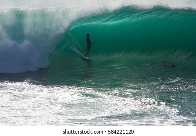 Padang Padang, Bali, Indonesia - May, 10, 2013: A surfer is seen here at Padang Padang surf spot getting barreled by a wave.