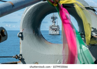 PADANG, INDONESIA - APRIL 11, 2016 : KRI Oswald Siahaan (354), Ahmad Yani class corvette of Indonesian Navy sails in front of another ship. view form mooring line hole of another ship.