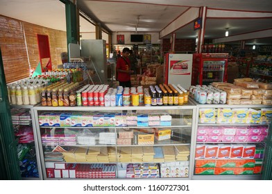 Padang, Indonesia - August 10, 2018: Local street stall is seen selling various snacks and drinks.