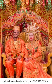 Padang, Indonesia - October 6 2017 : a couple of orang Minang, one of Indonesia Malay tribe during their traditional wedding ceremony in Indonesia.