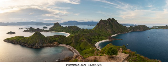 Padar island, Indonesia. Beautiful panorama view of the island with mountain and beach in sunset