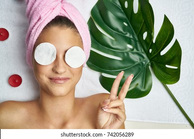 padded disks in front of a woman, peeling, skin care, cosmetic procedures