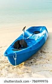 Paddle blue boat is on sandy beach, Maldives