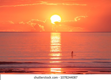 Paddle boarder in the sunset at Cable Beach, Broome, Western Australia.