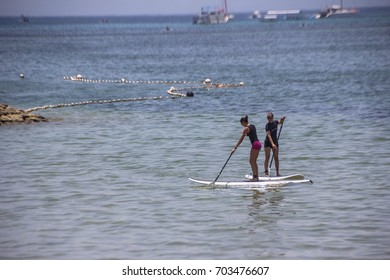 PADDLE BOARDING, BALI, INDONESIA -9th OCT 2016:-Paddle boarding is a great pastime and sport in Bali and Australia