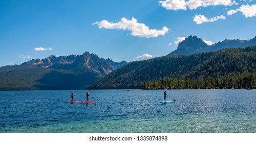 Paddle boarding on Redfish Lake in the Sawtooth Mountains in Idaho