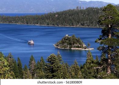 Paddle boat cruises toward Fannette Island on Lake Tahoe in California, USA.