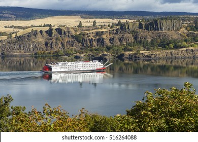 Paddle boat cruising up the Columbia River in the Columbia River Gorge which separates Oregon from Washington.