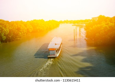 Paddle boat on the Chao Phraya River , Thailand with warm light , back side.