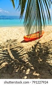 Paddle boat is on sandy beach, Maldives