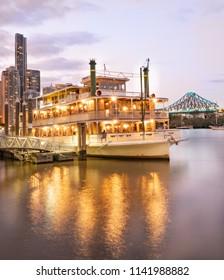 Paddle steamer and Brisbane City skyline at Brisbane river, Queensland, Australia