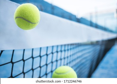 Paddle tennis ball shot go to net in traiing class, nobody in court