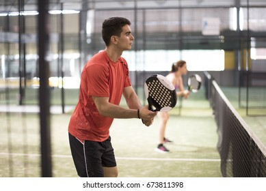 Paddle tennis couple in court ready for play and train