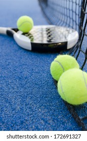 paddle tennis objects on artificial turf ready for tournament, focus in second ball