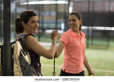 paddle tennis player ready for match in fair play hi five