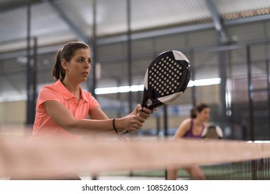 paddle tennis player ready for match, behind the net