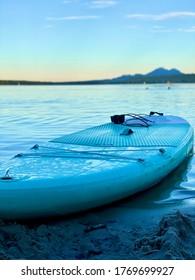 Paddleboard on the lake shore. sunset. Macha Lake Bezdez. Summer full of fun - Shutterstock ID 1769699927