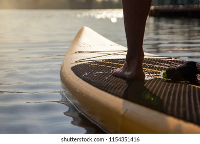 Paddleboarding on lake during sunset
