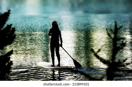 Paddleboarding  woman on stand up paddleboard