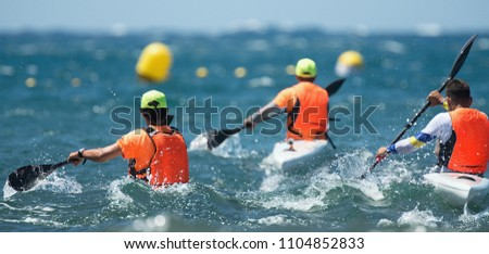 Paddlers race their ocean