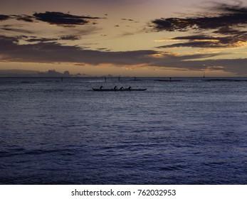 Paddling a canoe home in a Waikiki sunset