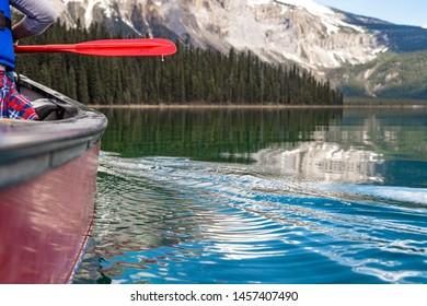 Paddling canoes on Emerald Lake