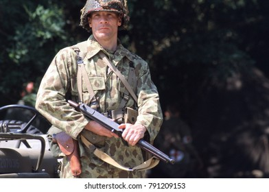Paddock Wood Kent 2002 a reenactor wears the uniform of a WW2 US Marine of the Pacific conflict 1945 he is armed with a Thompson Machine Gun. This image was taken in Kent England 2002