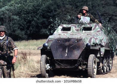 Paddock Wood Kent England 2003. WW2 German reenactors wearing uniform of the period and driving a Half Track personnel carrier recreate the Battle of Kursk 1943.
