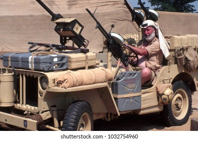 Paddock Wood Kent England 2003. An unidentified reenactor wears the uniform of a Special Air Services soldier and sits in a Jeep at a re-enactment of the Desert war in Africa 1943. Kent England.