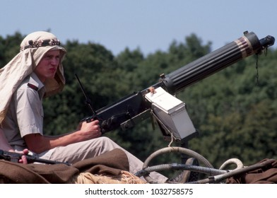 Paddock Wood Kent UK 2003. An unidentified re-enactor wears the uniform of a WW2 Desert Rat sitting on a vehicle and holding a Vickers Machine gun. Kent UK 2003.