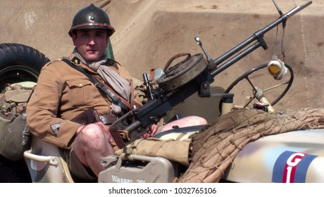 Paddock Wood Kent UK June 2003. An unidentified re-enactor wears the uniform of a WW2 French Foreign Legion Officer sitting in a Jeep at a re-enactment of the Desert War in Africa 1943.